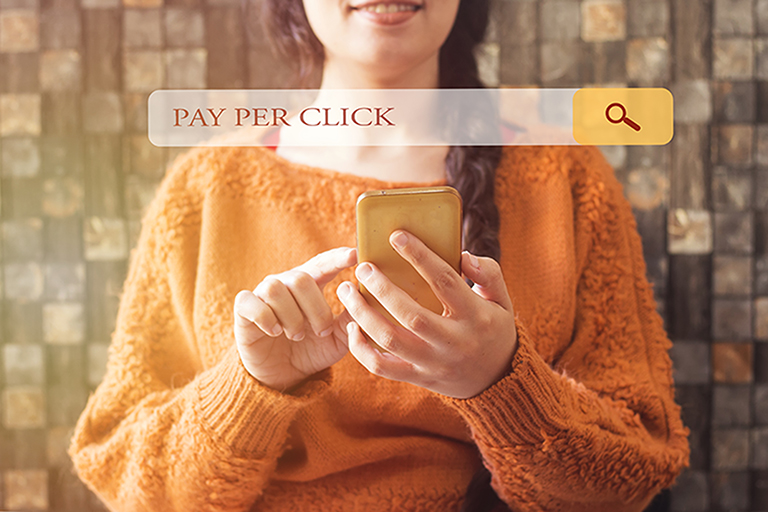 woman with beautiful smile and a braid hair and browsing pay per