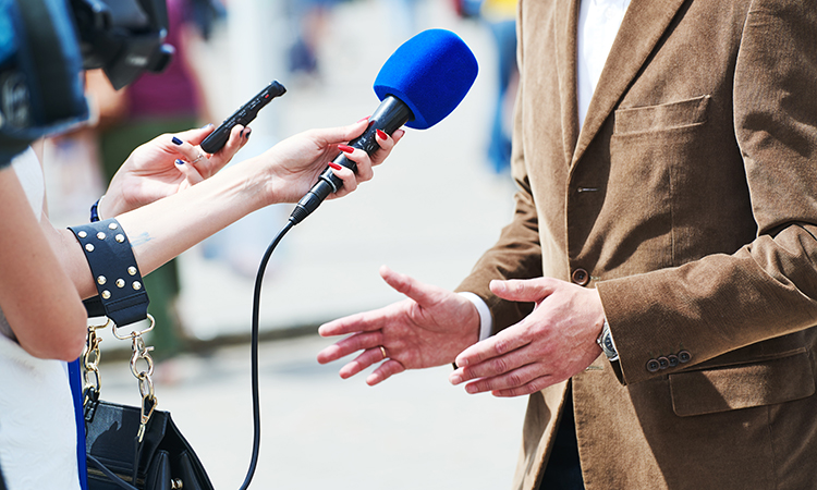 media reporter with microphone making journalist interview for news